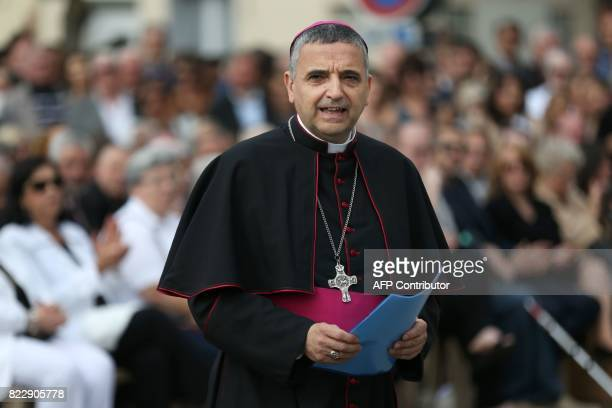 Archbishop of Rouen Dominique Lebrun walks to the podium to make a speech following a mass marking the first anniversary of the killing the French...