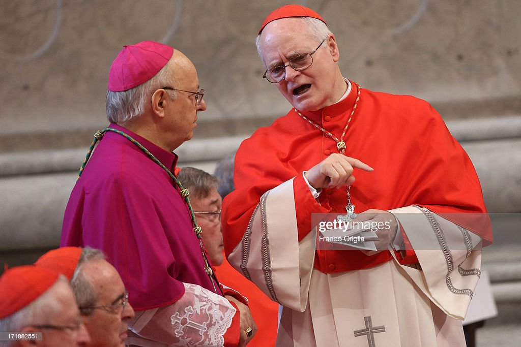 Archbishop of Sao Paulo, Cardinal Odilo Pedro Scherer (R) chats with a bishop during the mass and imposition of the Pallium upon the new metropolitan archbishops held by Pope Francis for the Solemnity of Saint Peter and Paul at Vatican Basilica on June 29, 2013 in Vatican City, Vatican. Pope Francis delivered the homily at Mass in St Peter's Basilica on Saturday morning, to mark the Solemnity of Saints Peter and Paul, Apostles and Patrons fo the city of Rome. In his remarks following the Gospel reading, the Holy Father focused on a particular task of the Petrine ministry, which is to strengthen, or confirm, all the faithful.
