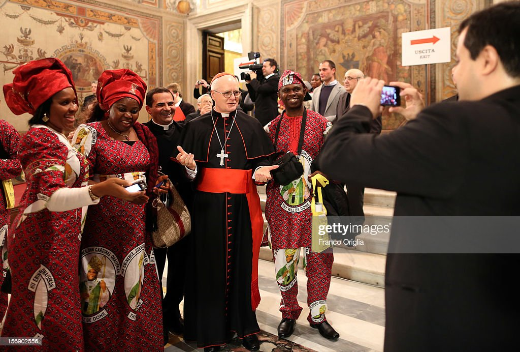 Archbishop of Sao Paulo Odilo Scherer poses with diocesans of the newly appointed cardinal John Olorunfemi Onaiyekan, archbishop of Abuja Nigeria, during the courtesy visits at the Sala Regia Hall at the end of the concistory held by Pope Benedict XVI on November 24, 2012 in Vatican City, Vatican. The Pontiff installed 6 new cardinals during the ceremony, who will be responsible for choosing his successor.