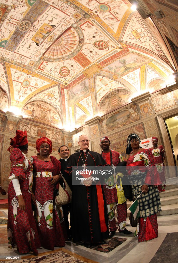 Archbishop of Sao Paulo Odilo Scherer poses with diocesans of the newly appointed cardinal John Olorunfemi Onaiyekan, archbishop of Abuja Nigeria, attend the courtesy visits at the Sala Regia Hall at the end of the concistory held by Pope Benedict XVI on November 24, 2012 in Vatican City, Vatican. The Pontiff installed 6 new cardinals during the ceremony, who will be responsible for choosing his successor.