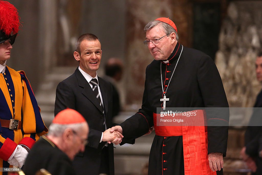 Archbishop of Sydney Cardinal <a gi-track='captionPersonalityLinkClicked' href=/galleries/search?phrase=George+Pell&family=editorial&specificpeople=695294 ng-click='$event.stopPropagation()'>George Pell</a> (R) attends a meeting of prayer at St. Peter's Basilica on March 6, 2013 in Vatican City, Vatican. The start-date of the conclave to elect a new Pope, following the resignation of Pope Benedict XVI, has yet to be confirmed as many cardinals have sought more time to discuss the issues currently facing the Catholic church.