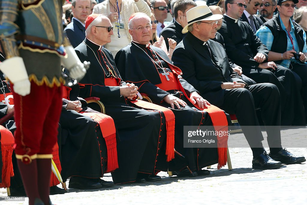 Archbishop of Sydney cardinal <a gi-track='captionPersonalityLinkClicked' href=/galleries/search?phrase=George+Pell&family=editorial&specificpeople=695294 ng-click='$event.stopPropagation()'>George Pell</a>, cardinal James M. Harvey and cardinal <a gi-track='captionPersonalityLinkClicked' href=/galleries/search?phrase=Marc+Ouellet&family=editorial&specificpeople=3145328 ng-click='$event.stopPropagation()'>Marc Ouellet</a> attend the swearing in ceremony for new members of the Vatican's elite Swiss Guard at the Cortile di San Damaso on May 6, 2014 in Vatican City, Vatican. The swearing in ceremony is held on May 6 every year to commemorate the 147 halberdiers who died defending the pope in 1527.
