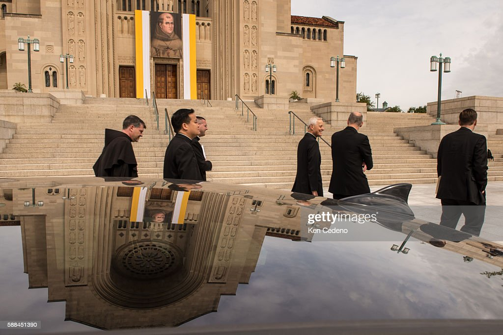 Archbishop of Washington Cardinal Donald W Wuerl center walks with staff viewing the front of the Basilica of the National Shrine of the Immaculate...