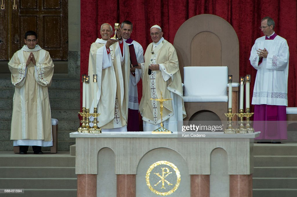 Archbishop of Washington Cardinal Donald W Wuerl holds up a chalis he recived from Pope Francis as he conducts mass and the Canonization of Blessed...
