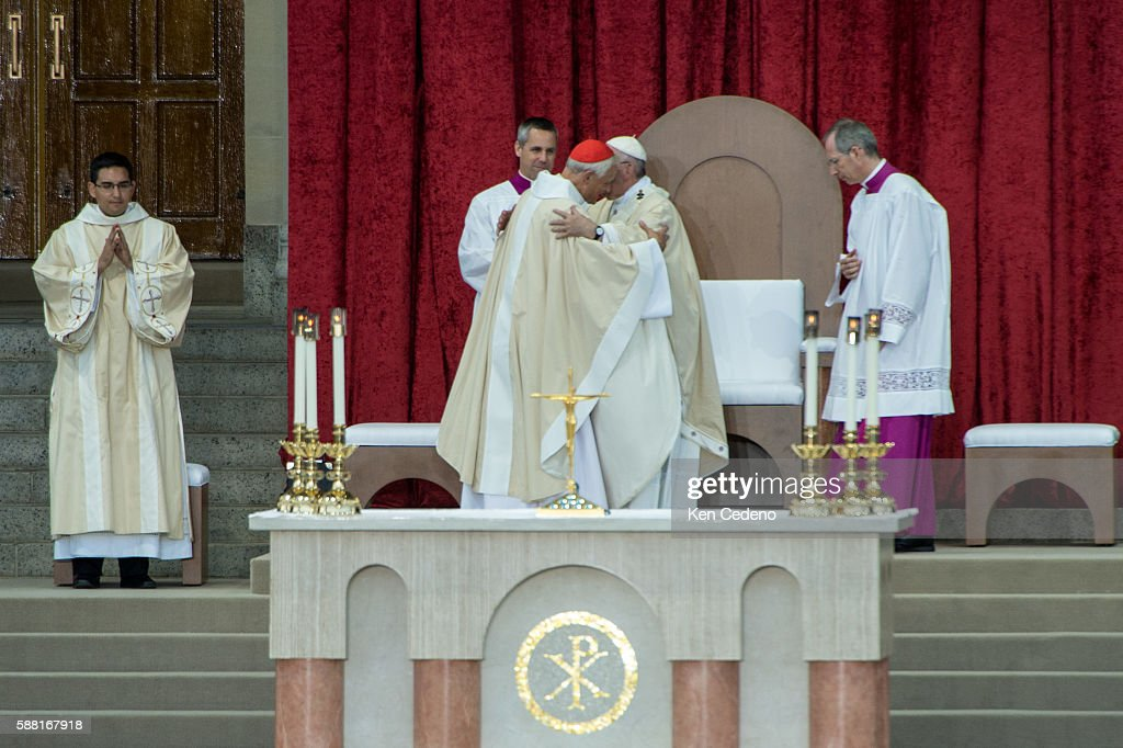 Archbishop of Washington Cardinal Donald W Wuerl hugs Pope Francis as he conducts mass and the Canonization of Blessed Junipero Serra at the Basilica...