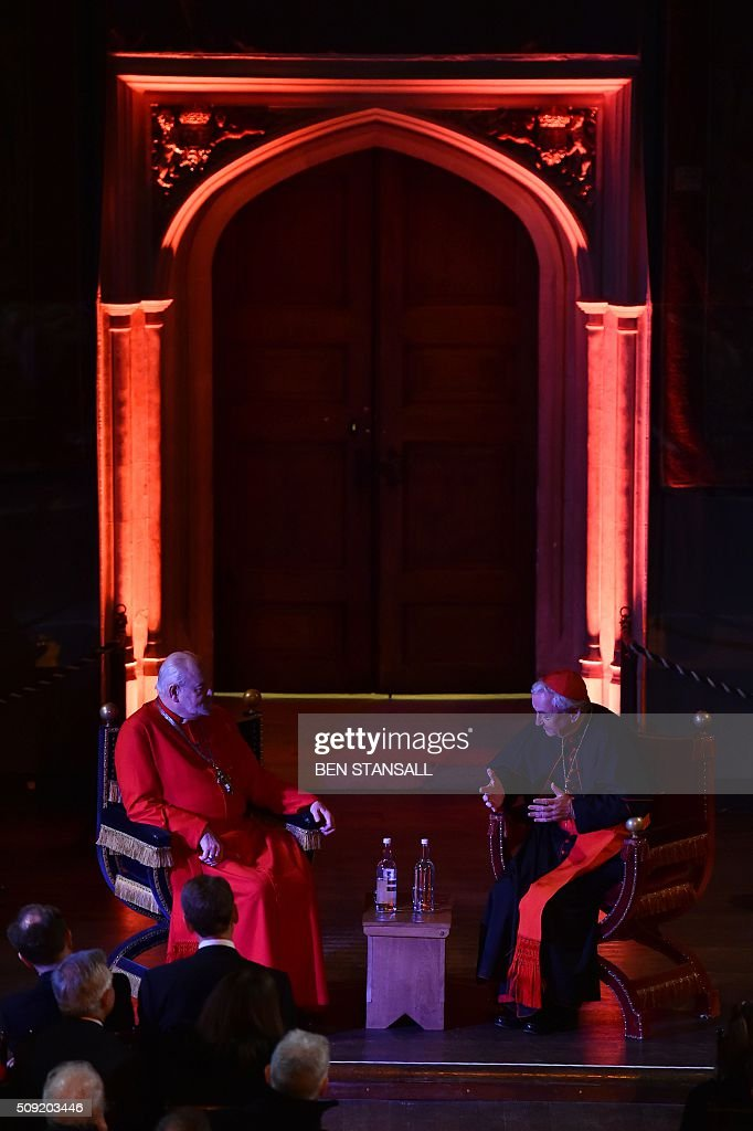 Archbishop of Westminster, Cardinal Vincent Nichols, the head of the Roman Catholic Church in England (R) and Wales and Bishop of London, Rt Revd Dr Richard Chartres (L) take part in a 'Conversation on Faith and the Crown' inside the Great Court ahead of a service at Hampton Court Palace, in south west London on February 9, 2016. The sounds of Latin song will echo through the halls of Hampton Court Palace in London on Tuesday for the first Catholic service in more than 450 years to be held in anti-Vatican king Henry VIII's residence. Cardinal Vincent Nichols, head of the Catholic Church in England, celebrates the Vespers with Anglican Bishop of London Richard Chartres in a symbolic gesture of reconciliation between the two churches. / AFP / Ben STANSALL