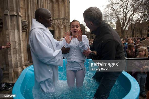 Archbishop of York Dr John Sentamu baptises Santa Mezaka 12 in a water tank during an Easter Saturday ceremony on April 7 2012 in York England...