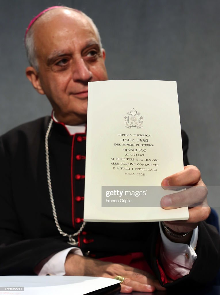 Archbishop <a gi-track='captionPersonalityLinkClicked' href=/galleries/search?phrase=Rino+Fisichella&family=editorial&specificpeople=2886869 ng-click='$event.stopPropagation()'>Rino Fisichella</a>, president of the Pontifical Council for Promoting the New Evangelisation holds a copy of Pope Francis' first encyclical, entitled 'Lumen Fidei' (The Light of Faith) during a press conference at the Holy See Press Office on July 5, 2013 in Vatican City, Vatican. The document continues many of Benedict's favourite themes, from the complementarity of faith and reason, to the joy of a personal encounter with Christ. Firmly situated in the Year of Faith, it's also set in the context of the 50th anniversary of the Second Vatican Council, which re-established the central role of Faith at the heart of all human relationships.
