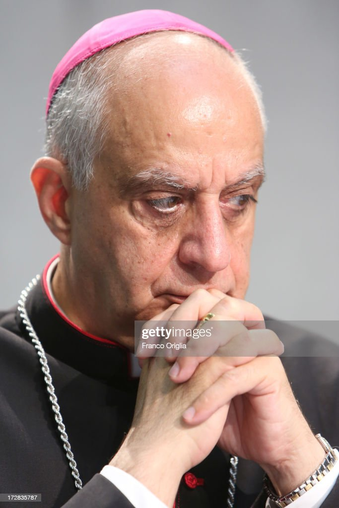 Archbishop <a gi-track='captionPersonalityLinkClicked' href=/galleries/search?phrase=Rino+Fisichella&family=editorial&specificpeople=2886869 ng-click='$event.stopPropagation()'>Rino Fisichella</a>, president of the Pontifical Council for Promoting New attends a press conference at the Holy See Press Office for the presentation of Pope Francis' first encyclical, entitled 'Lumen Fidei' (The Light of Faith) on July 5, 2013 in Vatican City, Vatican. The document continues many of Benedict's favourite themes, from the complementarity of faith and reason, to the joy of a personal encounter with Christ. Firmly situated in the Year of Faith, it's also set in the context of the 50th anniversary of the Second Vatican Council, which re-established the central role of Faith at the heart of all human relationships.