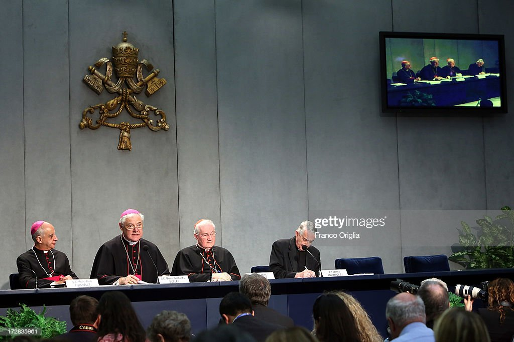 Archbishop <a gi-track='captionPersonalityLinkClicked' href=/galleries/search?phrase=Rino+Fisichella&family=editorial&specificpeople=2886869 ng-click='$event.stopPropagation()'>Rino Fisichella</a>, president of the Pontifical Council for Promoting the New Evangelisation, German archbishop Gerhard Ludwig Muller, Canadian Cardinal <a gi-track='captionPersonalityLinkClicked' href=/galleries/search?phrase=Marc+Ouellet&family=editorial&specificpeople=3145328 ng-click='$event.stopPropagation()'>Marc Ouellet</a>, prefect of the Congregation for the Doctrine of the Faith and father Federico Lombardi director of the Holy See Press Office, attend a press conference at the Holy See Press Office for the presentation of Pope Francis' first encyclical, entitled 'Lumen Fidei' (The Light of Faith) on July 5, 2013 in Vatican City, Vatican. The document continues many of Benedict's favourite themes, from the complementarity of faith and reason, to the joy of a personal encounter with Christ. Firmly situated in the Year of Faith, it's also set in the context of the 50th anniversary of the Second Vatican Council, which re-established the central role of Faith at the heart of all human relationships.
