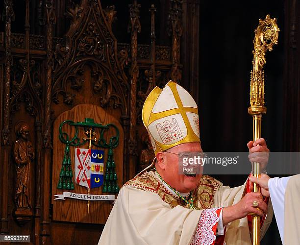Archbishop Timothy Dolan is handed the Holy scepter during his first service as Archbishop during his Mass of Installation at St Patrick's Cathedral...