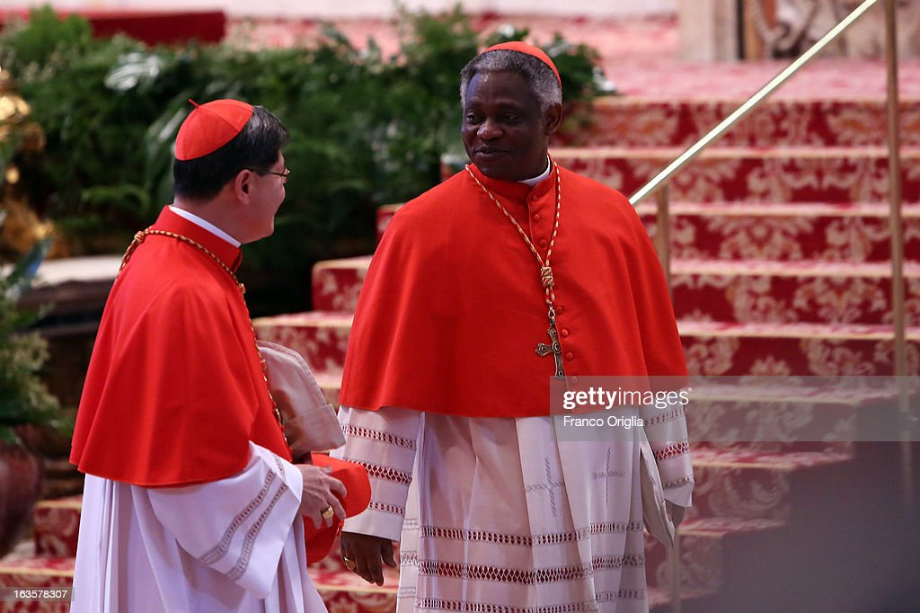 Archbisop of Manila cardinal Luis Antonio Tagle and Ghanian Cardinal Peter Appiah Turkson attend the Pro Eligendo Romano Pontifice Mass at St Peter's...
