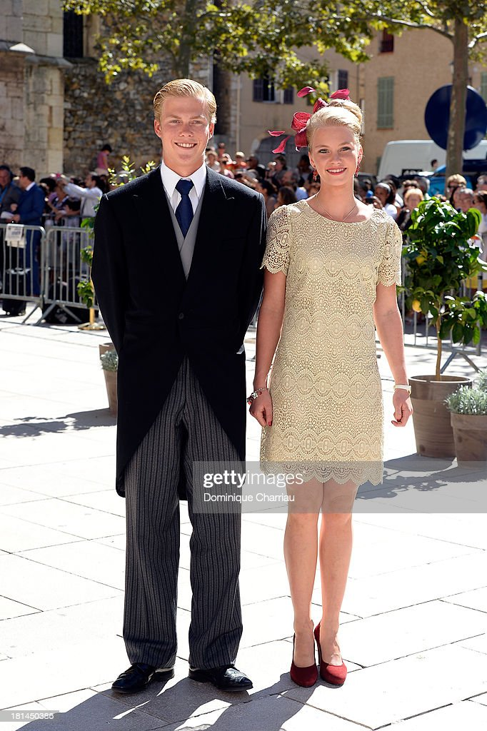 Archduke Alexander and Archduchess Gabriella depart the Religious Wedding Of Prince Felix Of Luxembourg and Claire Lademacher at Basilique Sainte Marie-Madeleine on September 21, 2013 in Saint-Maximin-La-Sainte-Baume, France.