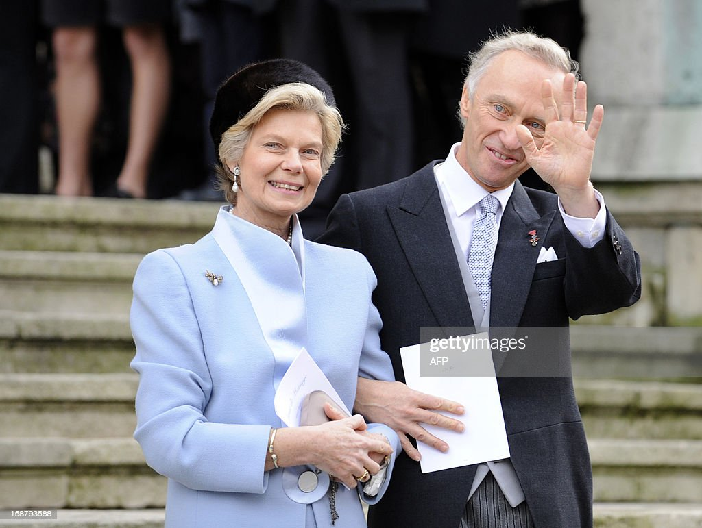 Archduke Christian of Austria and Archduchess Marie-Astrid of Austria, wave as they leave the Saint Epvre Basilica after the wedding of their son Archduke of Austria Christoph of Habsbourg-Lorraine with Archduchess Adelaide Drape-Frisch, on December 29, 2012, in Nancy.