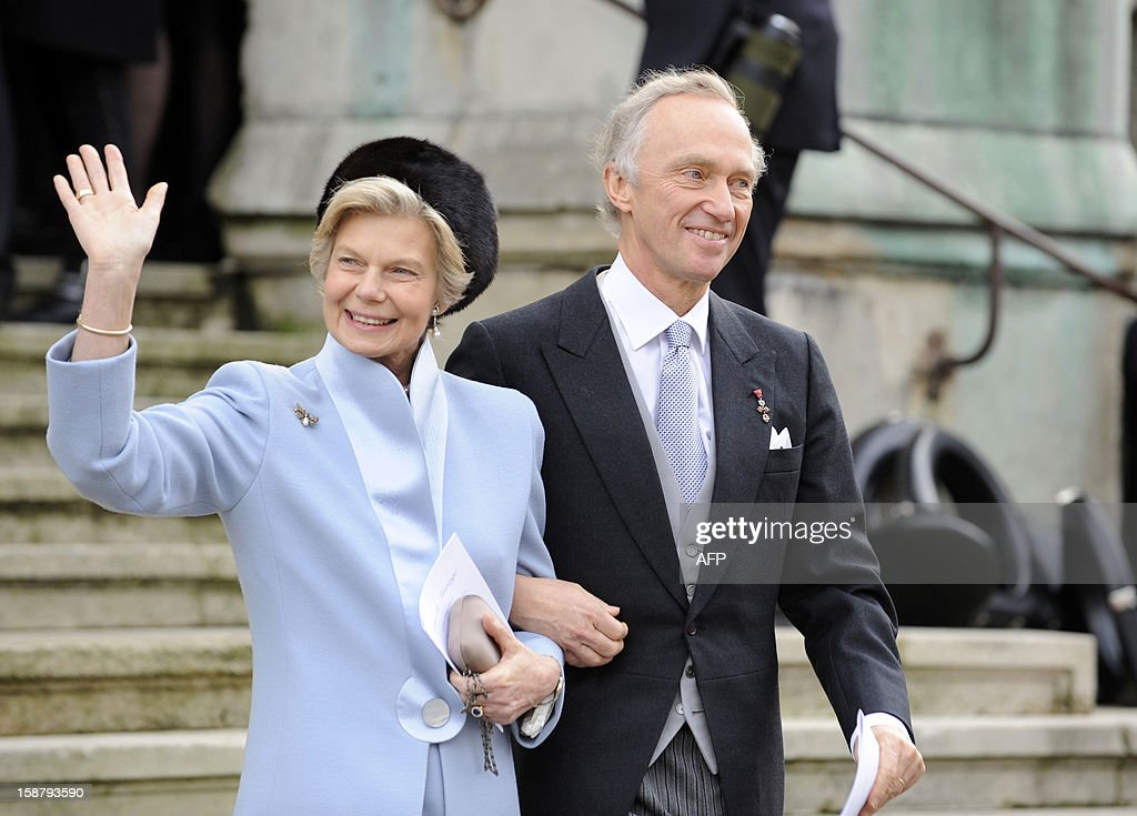 Archduke Christian of Austria and Archduchess Marie-Astrid of Austria, wave as they leave the Saint Epvre Basilica after the wedding of their son Archduke of Austria Christoph of Habsbourg-Lorraine with Archduchess Adelaide Drape-Frisch, on December 29, 2012, in Nancy. AFP PHOTO / JEAN-CHRISTOPHE VERHAEGEN