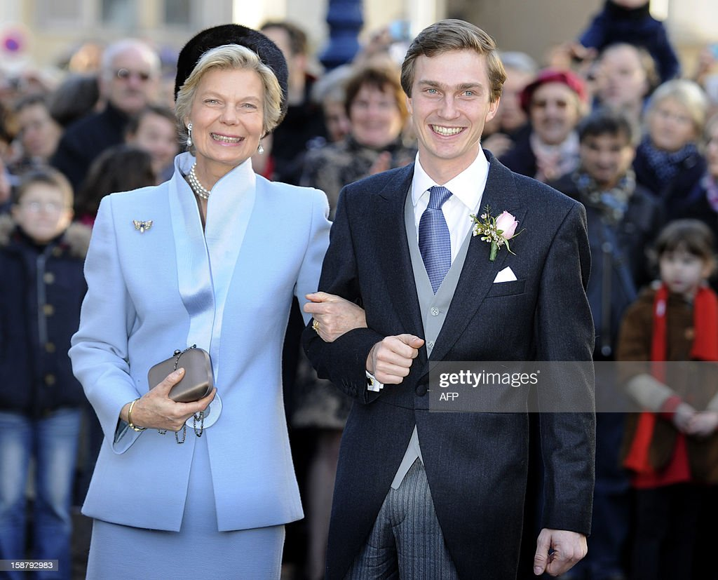 Archduke of Austria Christoph of Habsbourg (R) poses with his mother Archduchess Marie-Astrid of Austria in front of the Saint Epvre Basilica before his wedding with Adelaide Drape-Frisch, on December 29, 2012 in Nancy.