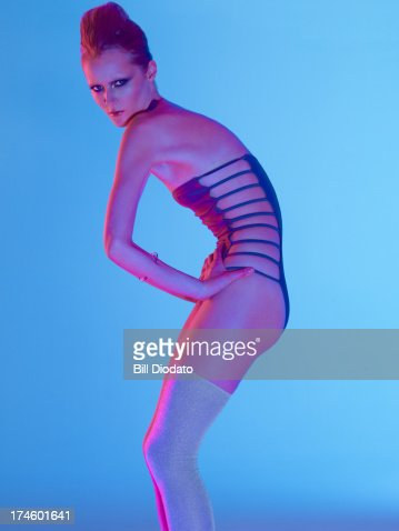 arched back woman in bathing suit : Stock Photo
