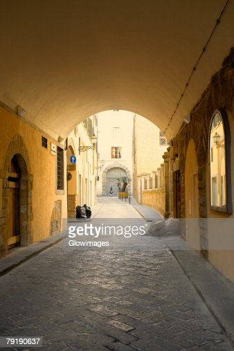 Arched corridor of a house, Florence, Italy : Stock Photo