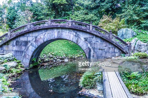Japanese Garden Stone Bridge arched stone bridge in japanese garden stock photo | getty images