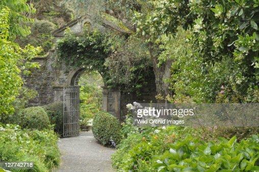 Arched stone gateway through walled garden stock photo for Garden gateway