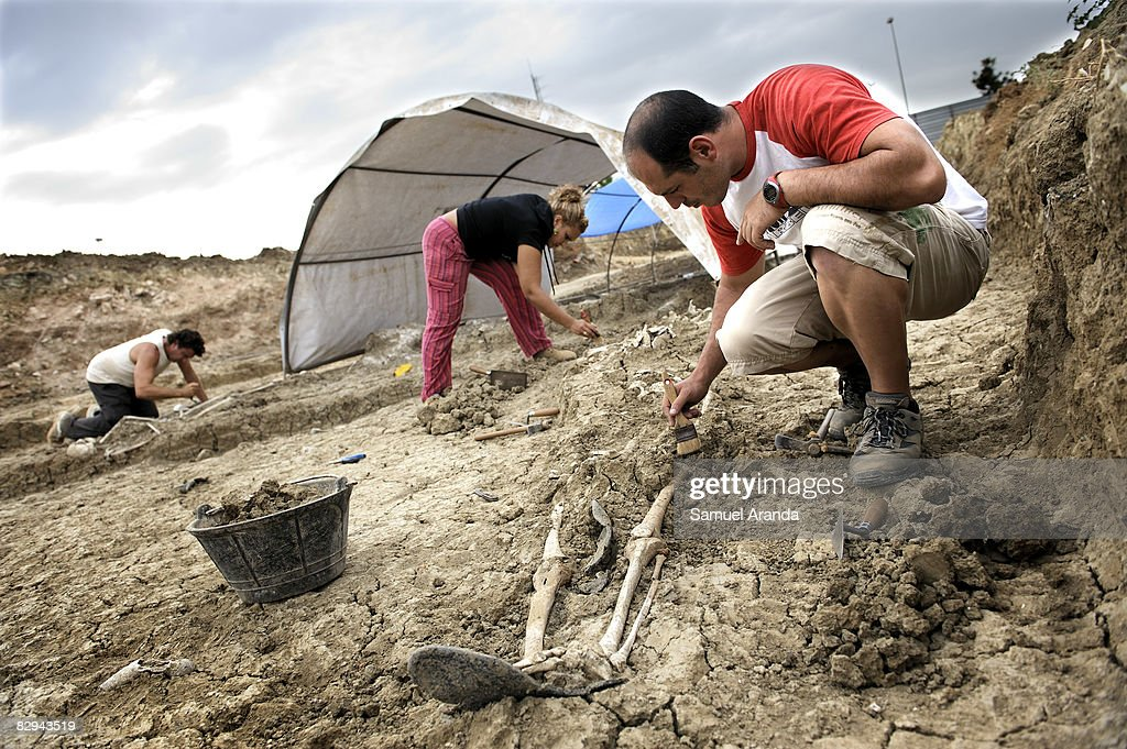 Archelogists work exhuming human remains at the San Rafael mass grave where an estimated of 4500 bodies where found September 9 2008 in Malaga Spain...