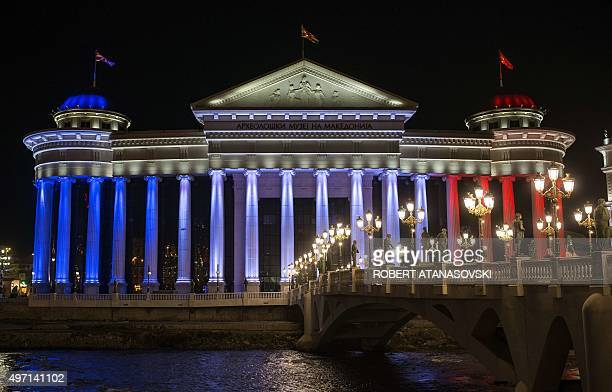 Archeological museum is illuminated with the colours of the French national flag in Skopje on November 14 in tribute to the victims of deadly attacks...