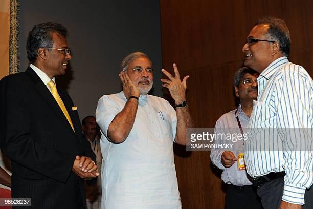 Archeological Survey of India's Director General Gautam Sengupta Gujarat state Chief Minister Narendra Modi and UNESCO New Delhi Director Armoogum...
