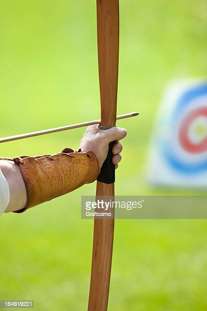 Archer about to shoot with bow and arrow