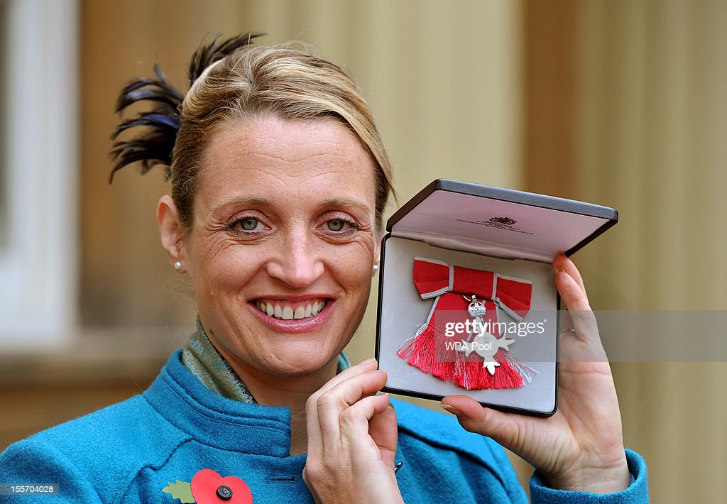 Archer Alison Williamson holds her member of the British Empire (MBE) medal following an Investiture Ceremony hosted by the Princess Royal at Buckingham Palace on November 7, 2012 in London, England.