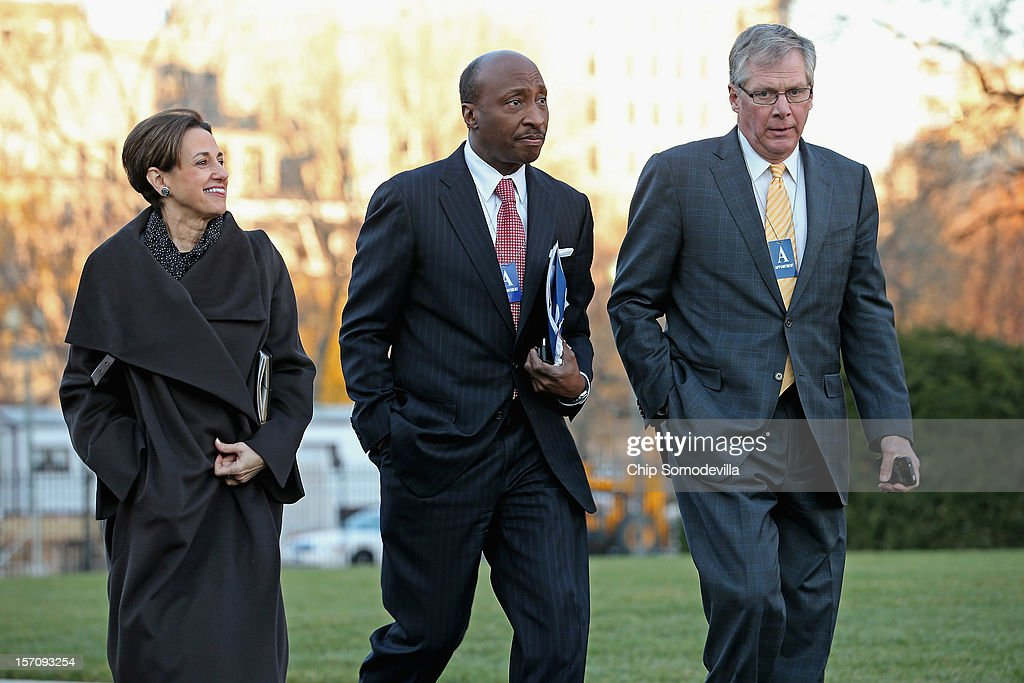 Archer Daniels Midland President and CEO Patricia Woertz, Merck President and CEO Ken Frazier and Caterpillar Chairman and CEO Douglas Oberhelman arrive at the White House for a meeting with President Barack Obama and other business leaders November 28, 2012 in Washington, DC. According to the White House, the American business executives met with Obama to discuss economic growth and deficit reduction.