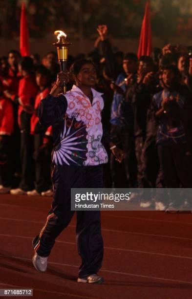 Archer Deepika Kumari runing with ceremonial torch during the inagural function 34th National Game at Birsa Munda Athletic stadium Hotwar in Ranchi