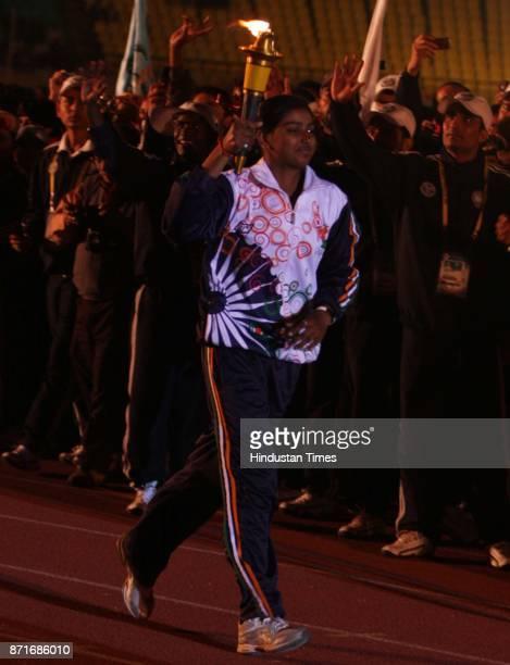 Archer Deepika Kumari runing with ceremonial torch during the inagural function of 34th National Game at Birsa Munda Athletic stadium Hotwar in Ranchi