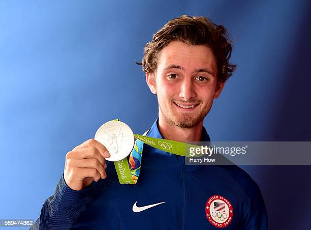 Archer Zach Garrett of the United States poses for a photo with his silver medal on the Today show set on Copacabana Beach on August 13 2016 in Rio...