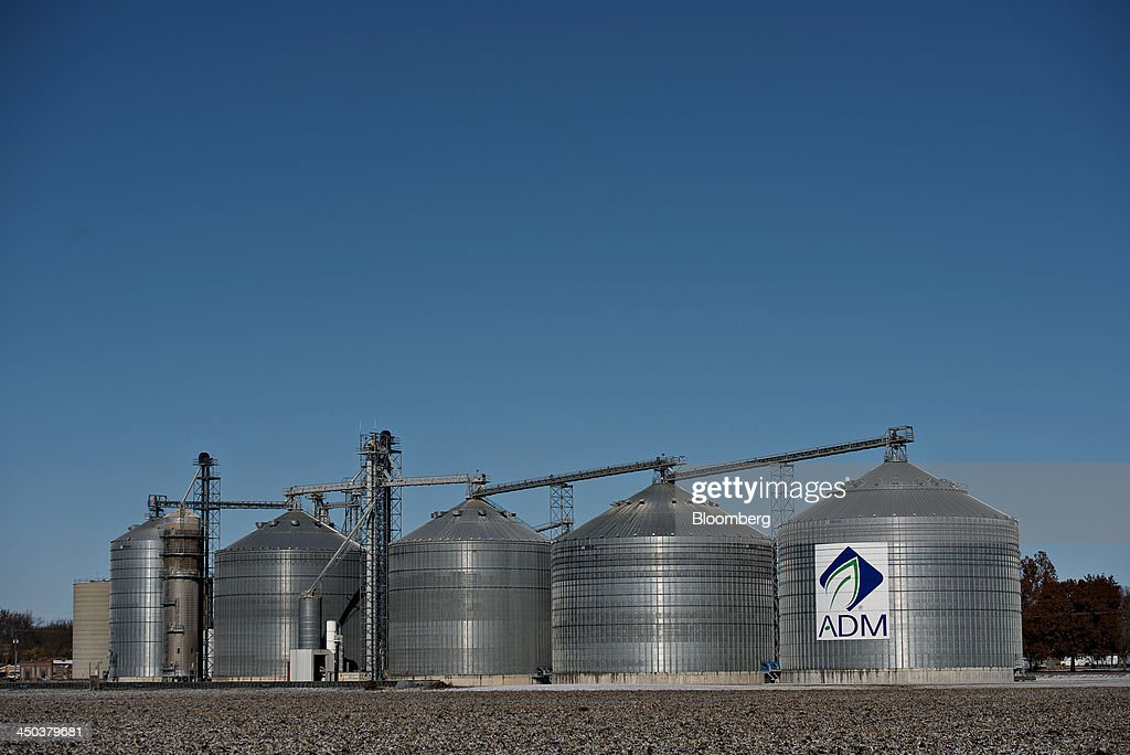 Archer-Daniels-Midland Co. (ADM) signage is displayed on the side of a grain storage bin at an ADM grain elevator in Niantic, Illinois, U.S., on Tuesday, Nov. 12, 2013. Archer-Daniels-Midland Co. procures, transports, stores, processes, and merchandises agricultural commodities and products as well as processes oilseeds, corn, milo, oats, barley, peanuts, and wheat. Photographer: Daniel Acker/Bloomberg via Getty Images