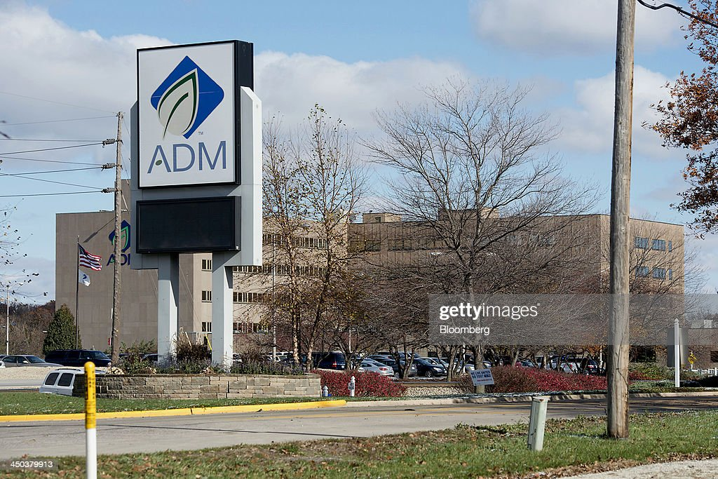 Archer-Daniels-Midland Co. (ADM) signage is displayed outside of the company's headquarters in Decatur, Illinois, U.S., on Tuesday, Nov. 12, 2013. Archer-Daniels-Midland Co. procures, transports, stores, processes, and merchandises agricultural commodities and products as well as processes oilseeds, corn, milo, oats, barley, peanuts, and wheat. Photographer: Daniel Acker/Bloomberg via Getty Images