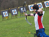 A young boy on a archery competition