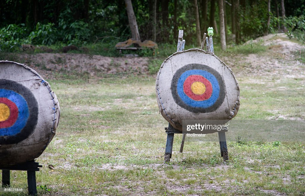 Archery target on the field,light and flare effect added : Stockfoto