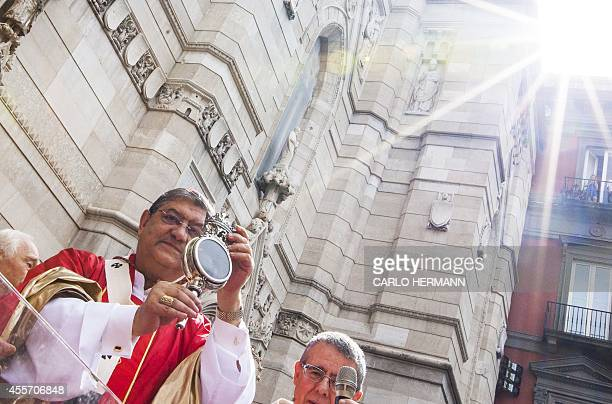 Archibishop of Naples Crescenzio Sepe shows the faithful the ampoule with the melted blood out of Naples Cathedral during the celebrations of Saint...