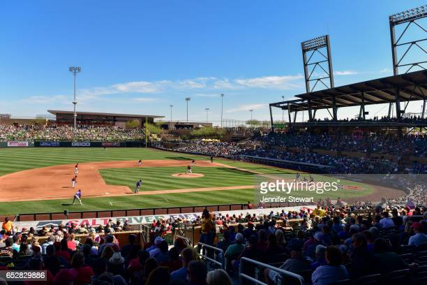 Archie Bradley of the Arizona Diamondbacks delivers a pitch against the Colorado Rockies during the spring training game at Salt River Fields at...