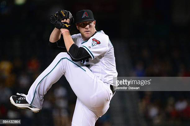Archie Bradley of the Arizona Diamondbacks delivers a pitch during the first inning against the Atlanta Braves at Chase Field on August 23 2016 in...