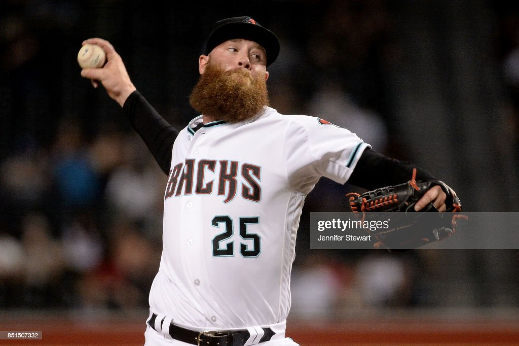 Archie Bradley #25 of the Arizona Diamondbacks delivers a pitch in the eighth inning of the MLB game against the San Francisco Giants at Chase Field on September 26, 2017 in Phoenix, Arizona.