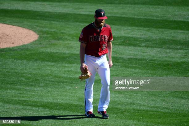 Archie Bradley of the Arizona Diamondbacks is relieved during the spring training game against the Colorado Rockies at Salt River Fields at Talking...