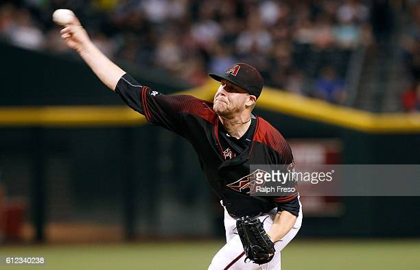 Archie Bradley of the Arizona Diamondbacks pitches against the San Diego Padres during the second inning of a MLB game at Chase Field on October 1...
