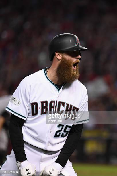 Archie Bradley of the Arizona Diamondbacks reacts after hitting a RBI triple during the bottom of the seventh inning of the National League Wild Card...