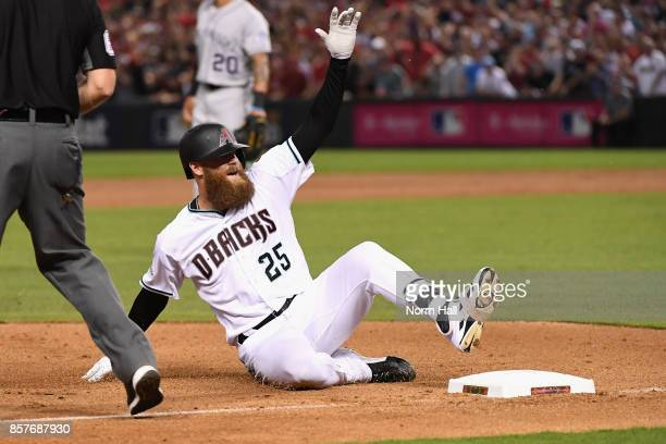 Archie Bradley of the Arizona Diamondbacks slides into third base during bottom of the seventh inning of the National League Wild Card game against...