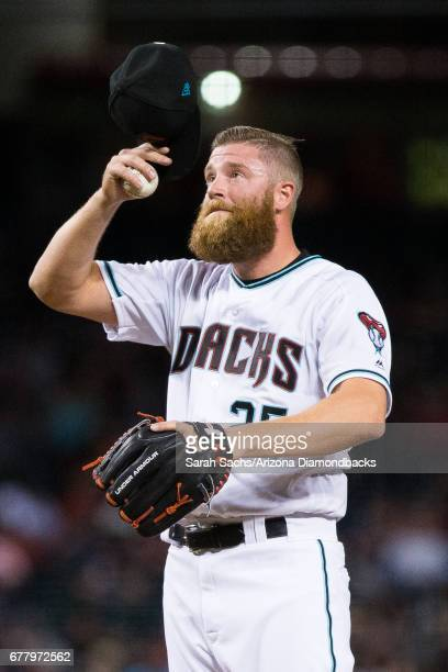Archie Bradley of the Arizona Diamondbacks takes a moment to prepare before delivering a pitch at Chase Field on April 4 2017 in Phoenix Arizona
