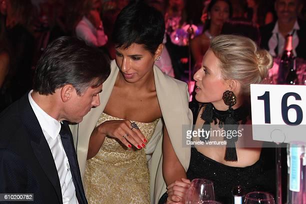 Archie Drury Deena Abdulaziz and Karolina Kurkova attend the dinner of amfAR Milano 2016 at La Permanente on September 24 2016 in Milan Italy