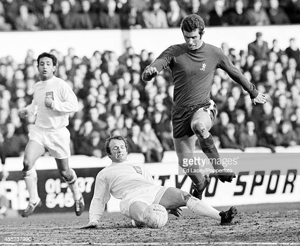 Archie Gemmell of Preston North End tackles Peter Osgood of Chelsea during their FA Cup 4th round replay at Stamford Bridge on 3rd February 1969...