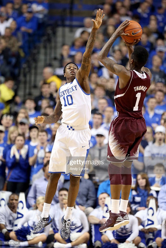 <a gi-track='captionPersonalityLinkClicked' href=/galleries/search?phrase=Archie+Goodwin&family=editorial&specificpeople=9086088 ng-click='$event.stopPropagation()'>Archie Goodwin</a> #10 of the Kentucky Wildcats defendes the shot of Fred Thomas #1 of the Mississippi State Bulldogs during the game at Rupp Arena on February 27, 2013 in Lexington, Kentucky.