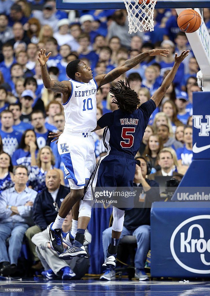 Archie Goodwin #10 of the Kentucky Wildcats defends the shot of <a gi-track='captionPersonalityLinkClicked' href=/galleries/search?phrase=Russell+Wilson+-+American+Football+Quarterback&family=editorial&specificpeople=2292912 ng-click='$event.stopPropagation()'>Russell Wilson</a> #5 of the Samford Bulldogs during the game at Rupp Arena on December 4, 2012 in Lexington, Kentucky. Kentucky won 88-56.